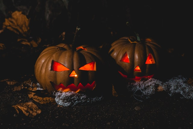 2 scary pumpkins in the dark